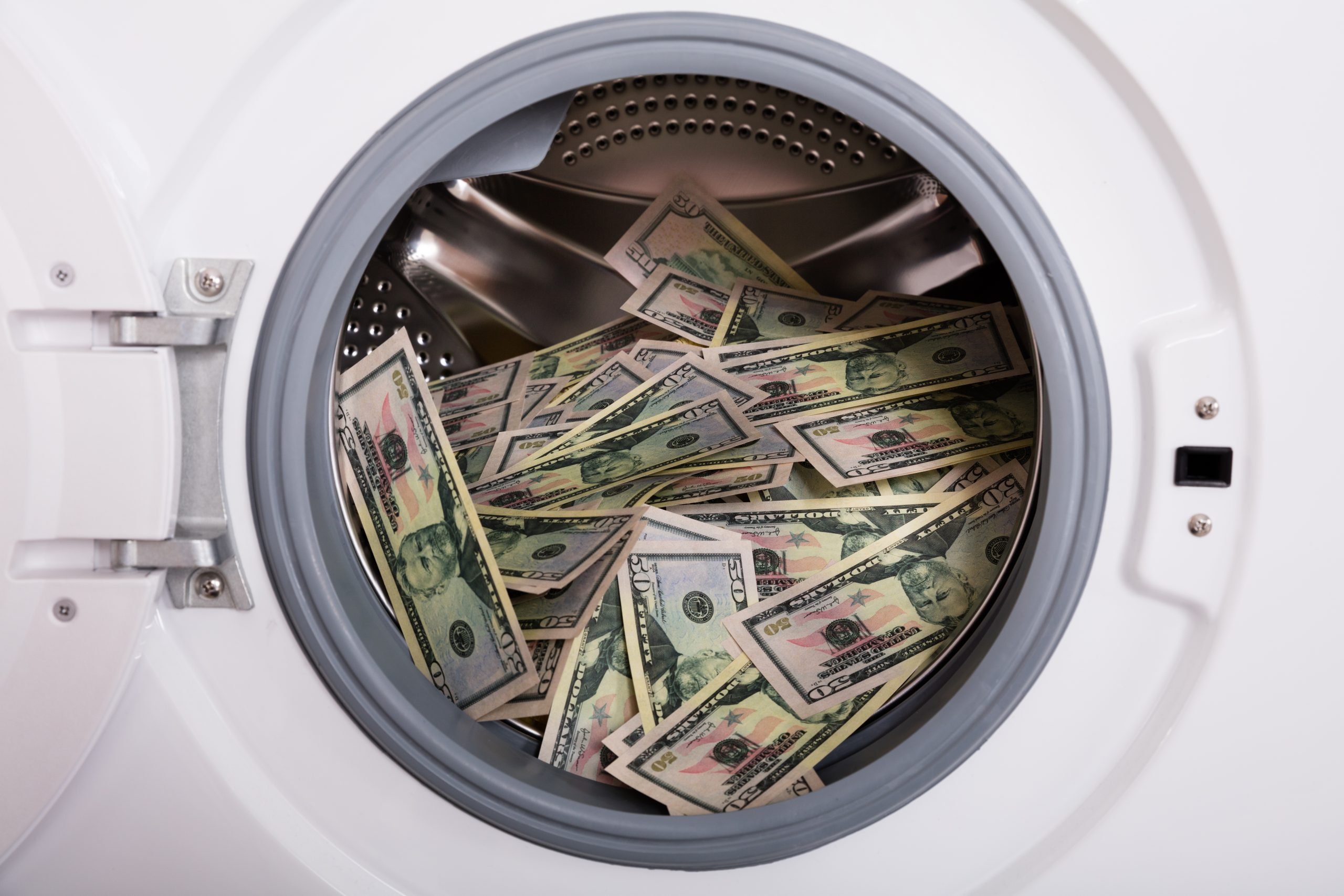 close up,of,pile,of,dirty,money,placed,in,washing,machine