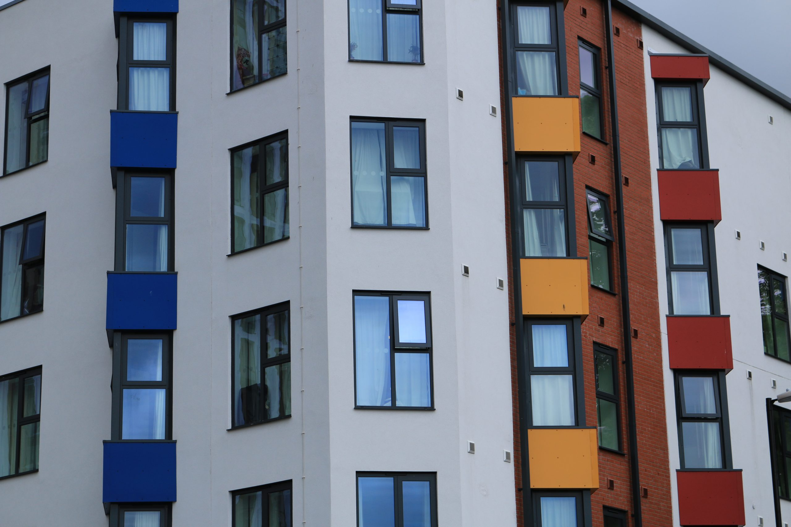 close,up,of,red,,yellow,and,blue,window,panels,from